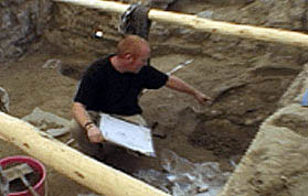 roddy pointing into and excavation