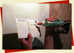 puting glue on the back of the card